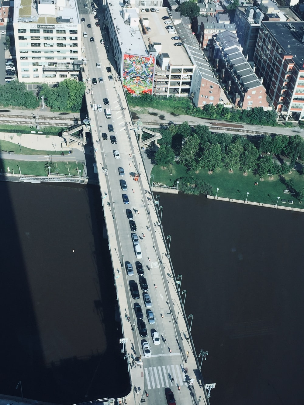 aerial photography of vehicles traveling on bridge during daytime