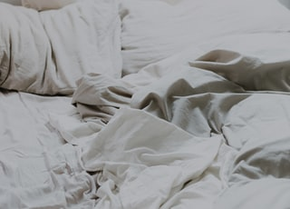 white pillows and bed comforter
