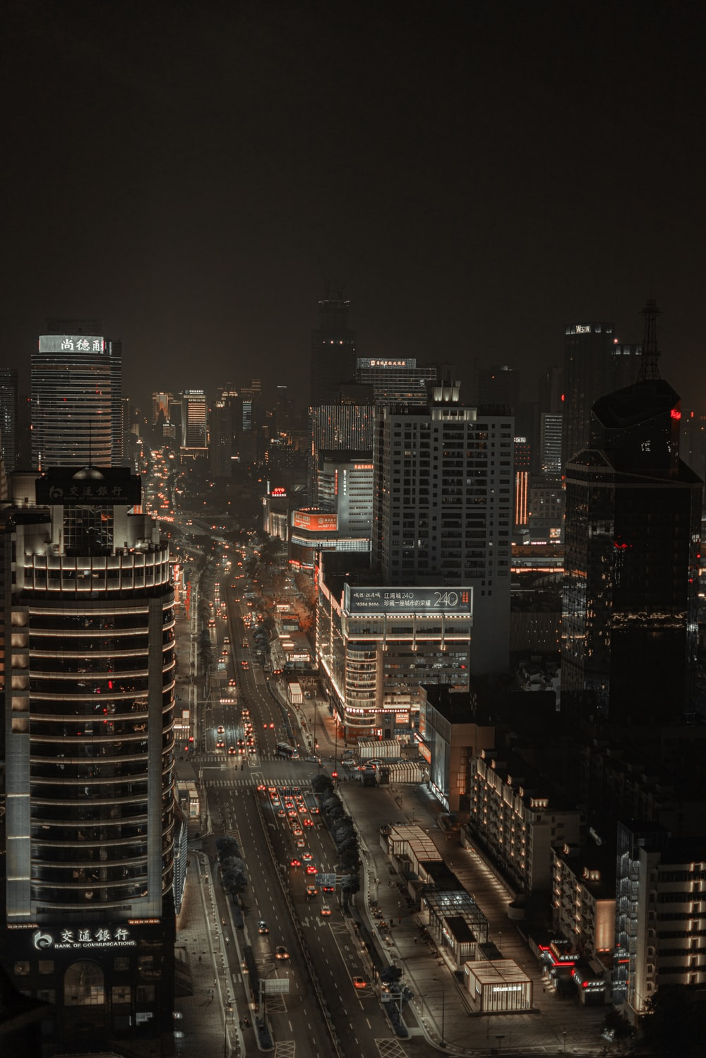 city buildings and traffic lights during nighttime