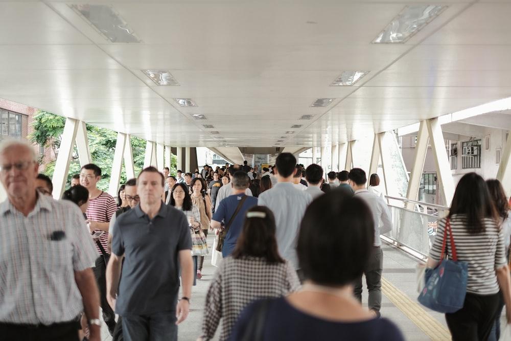 group of people walking inside building