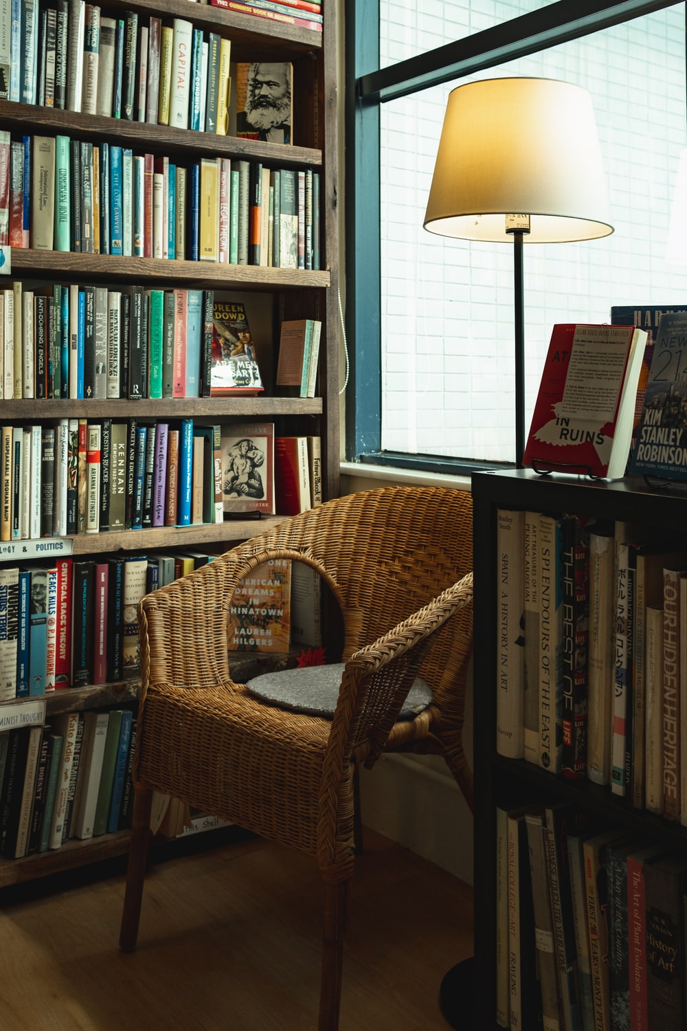 brown wicker chair and books