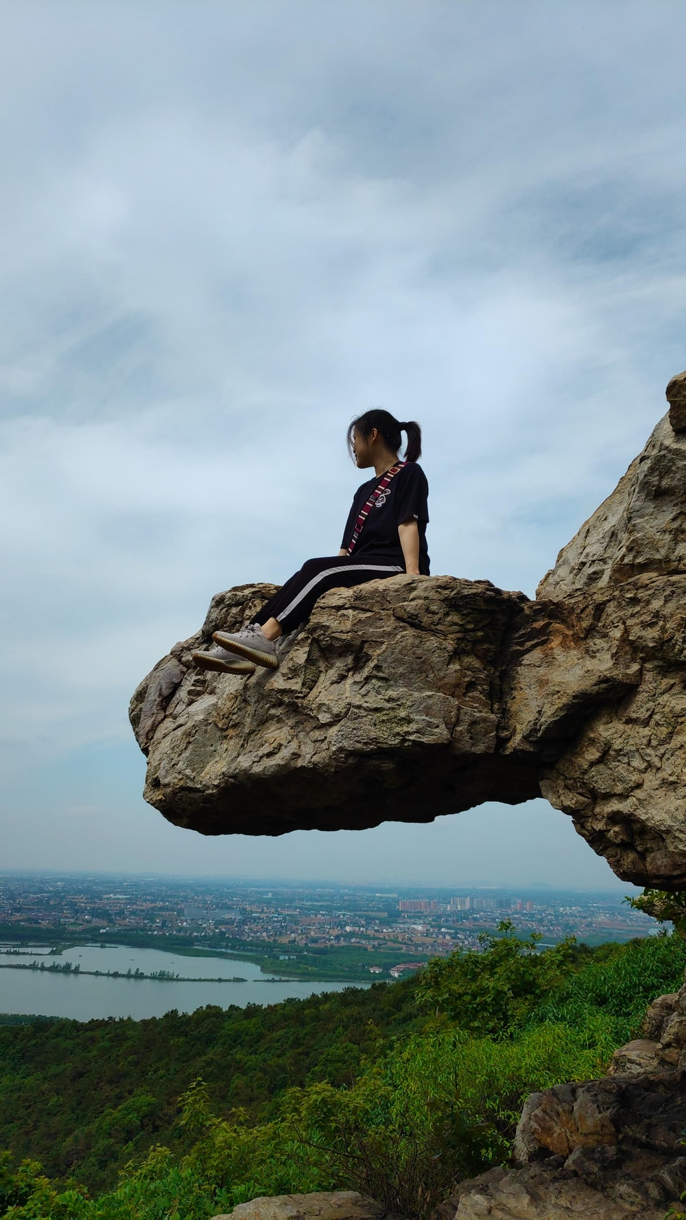 woman sitting on rock formation