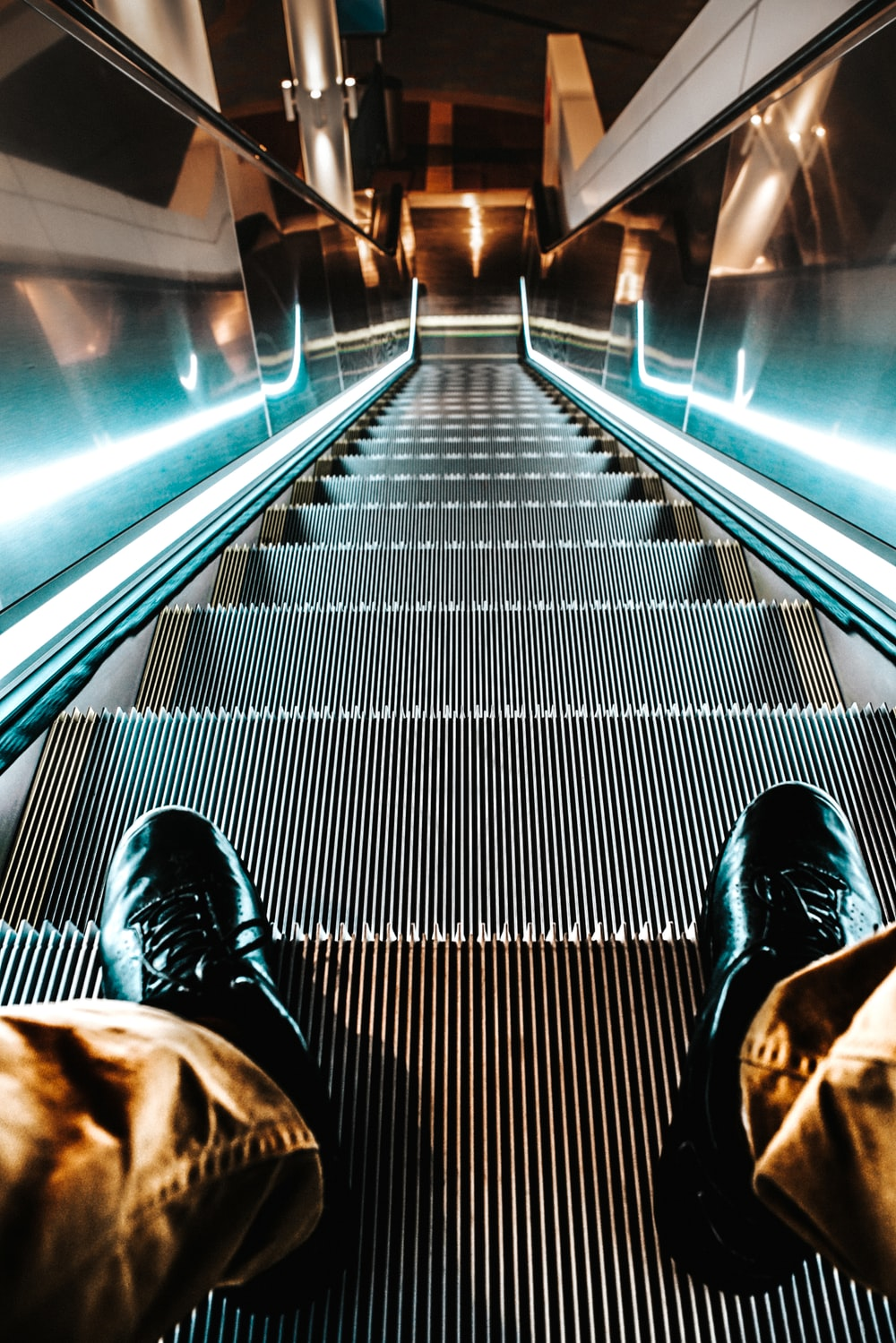 person on escalator