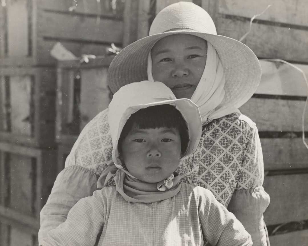 1937. Japanese mother and daughter, agricultural workers near Guadalupe, California. Photographer: Dorothea Lange