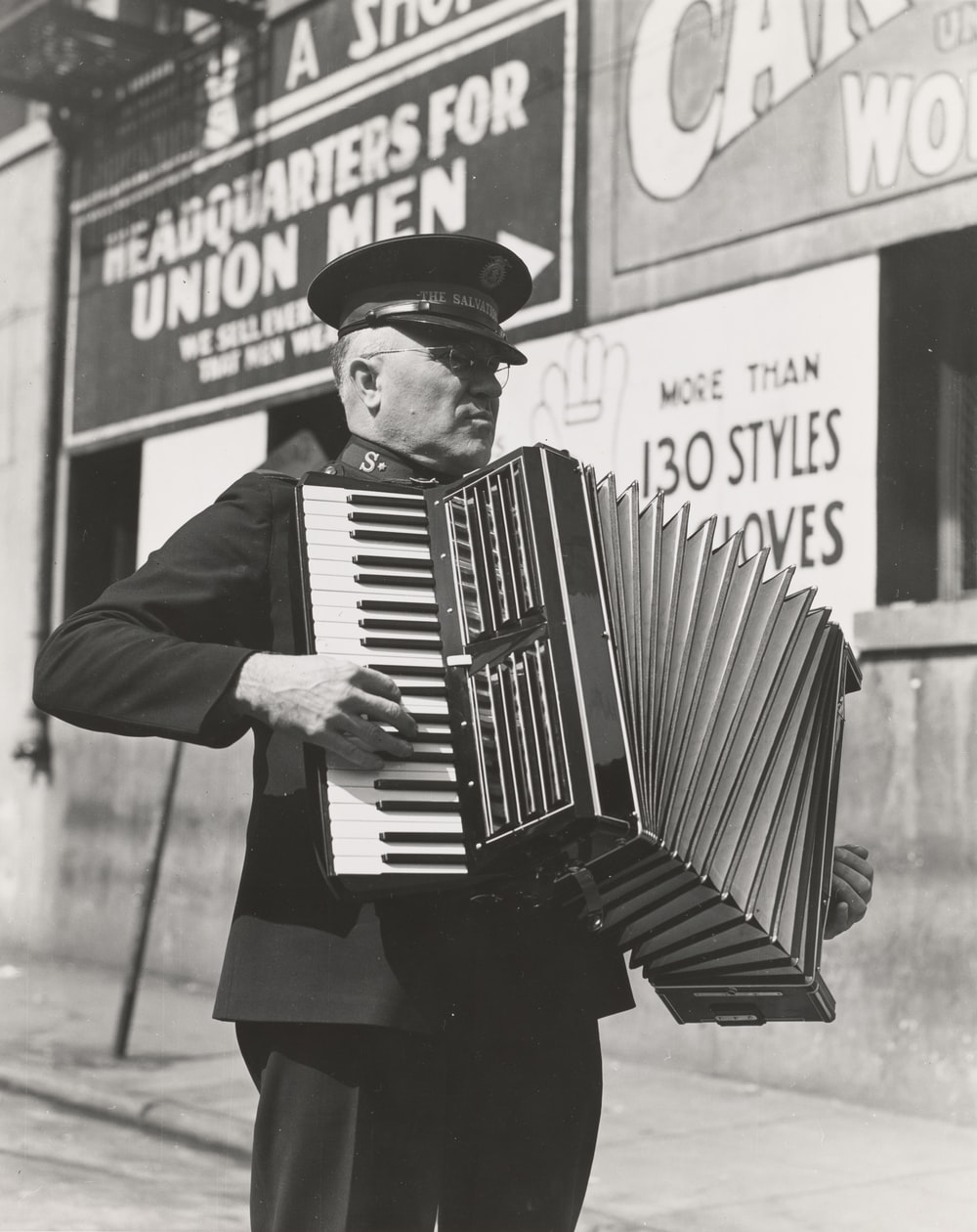 grayscale photo of man playing accordion