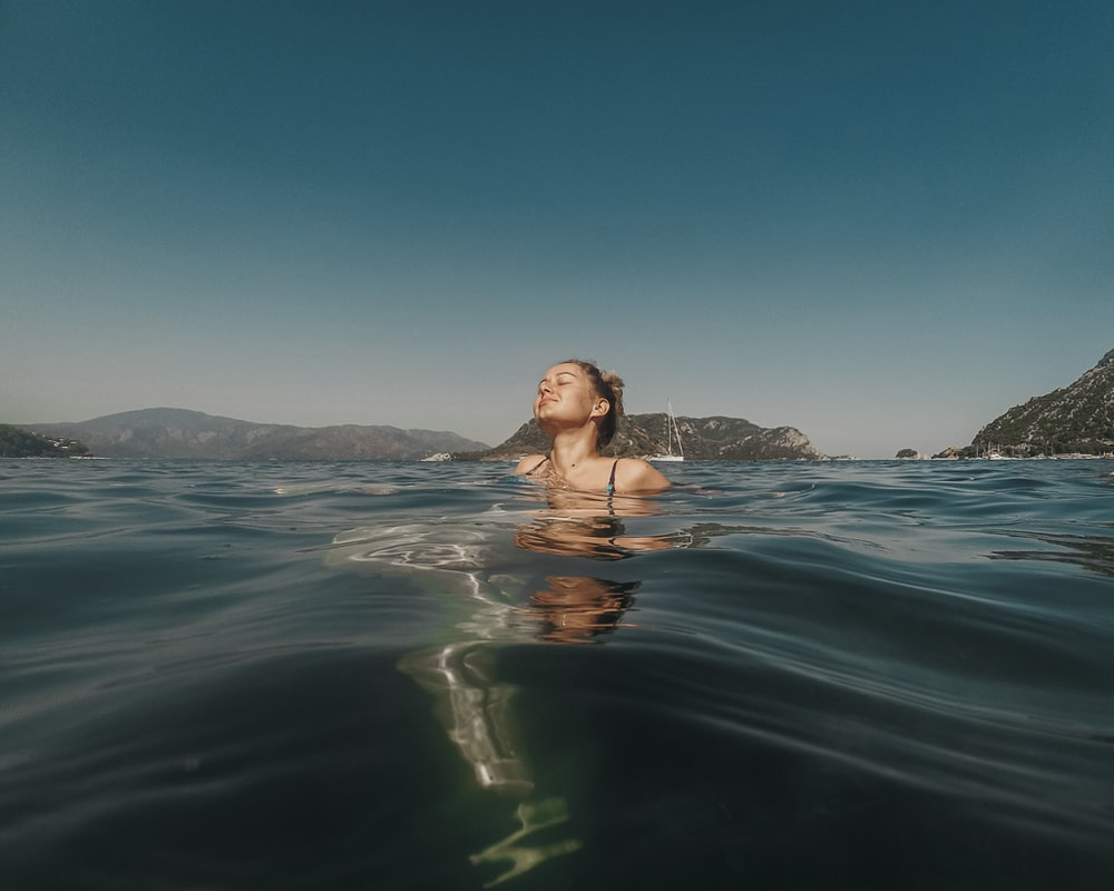 woman swimming in the water