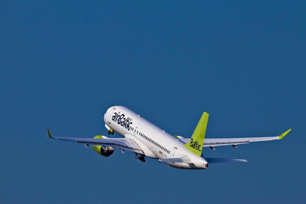 white and green Air Baltic passenger plane