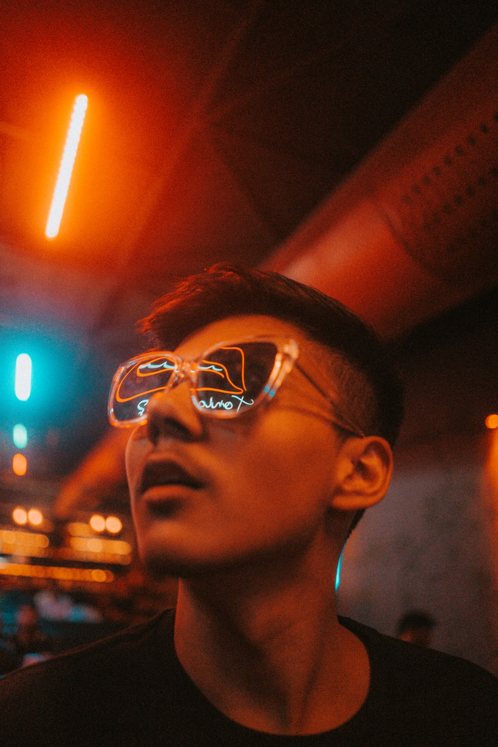 man in sunglasses looking up
