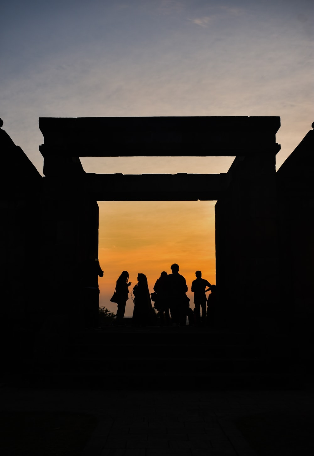 silhouette of group of men during sunset
