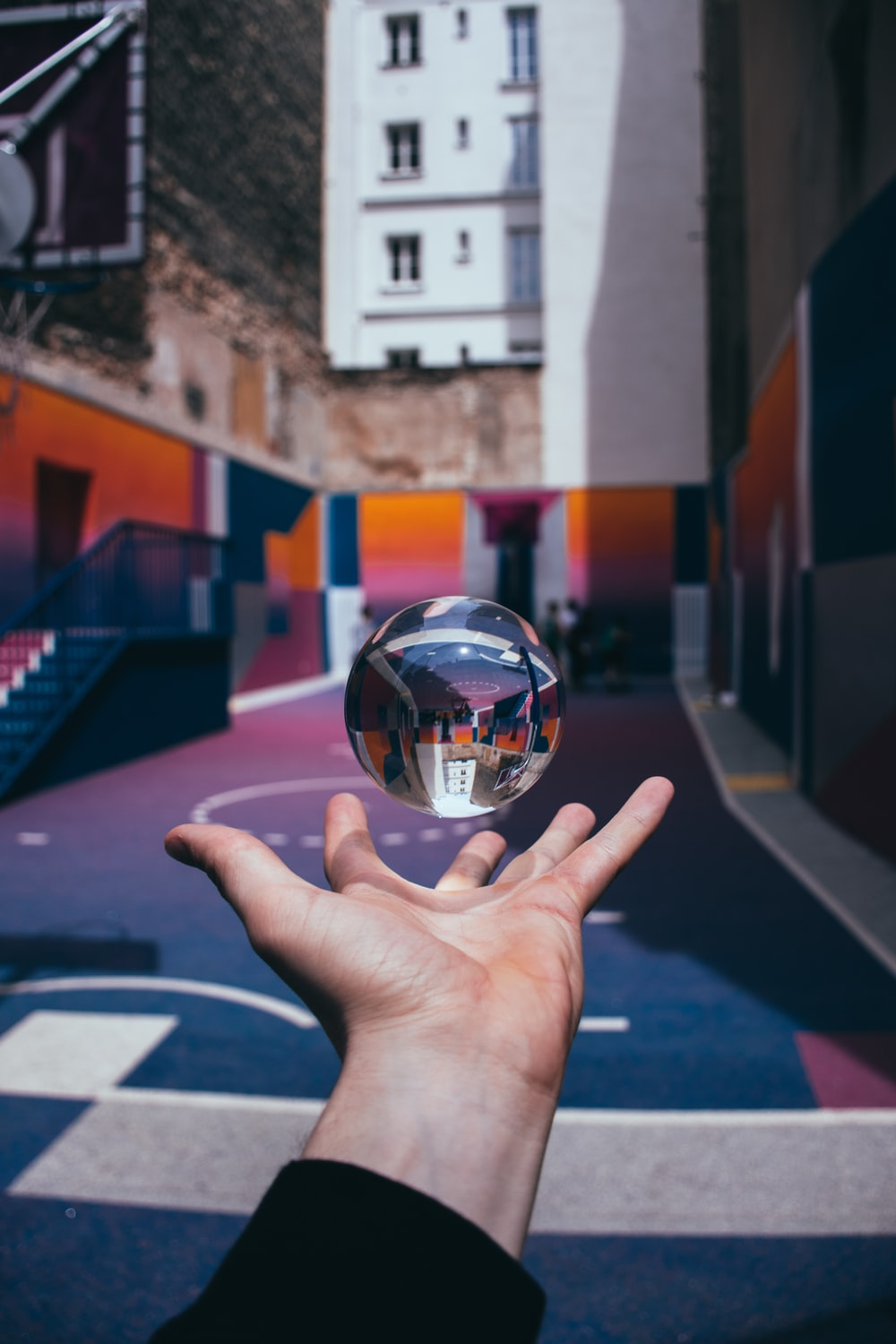 glass ball elevating on person's palm
