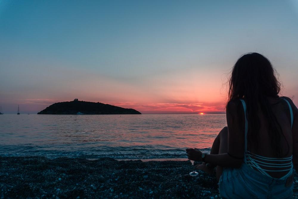 silhouette of woman on seashore