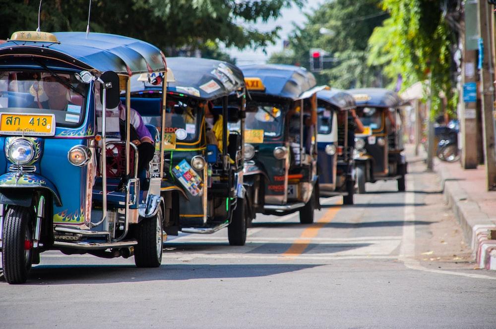 blue-and-yellow autorickshaws