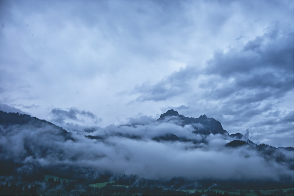 clouds near mountain during daytime
