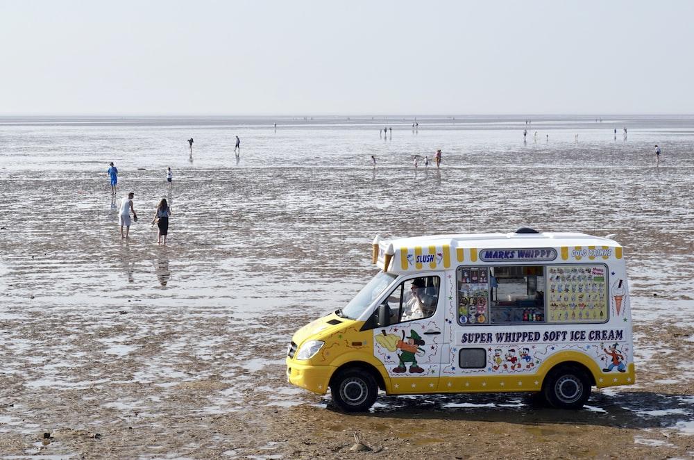 white and yellow soft ice cream van