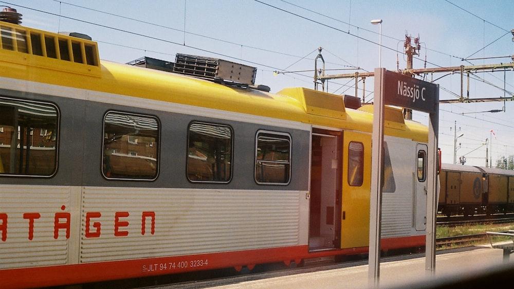 white, yellow, and gray train
