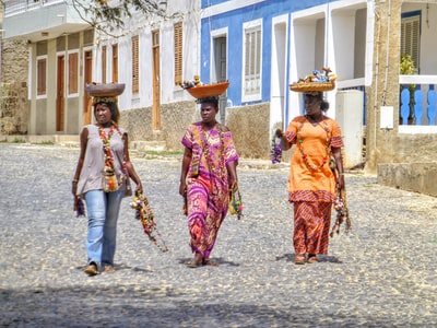 three woman carrying basket over their heads cabo verde zoom background