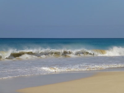 shoreline and ocean waves during daytime cabo verde zoom background