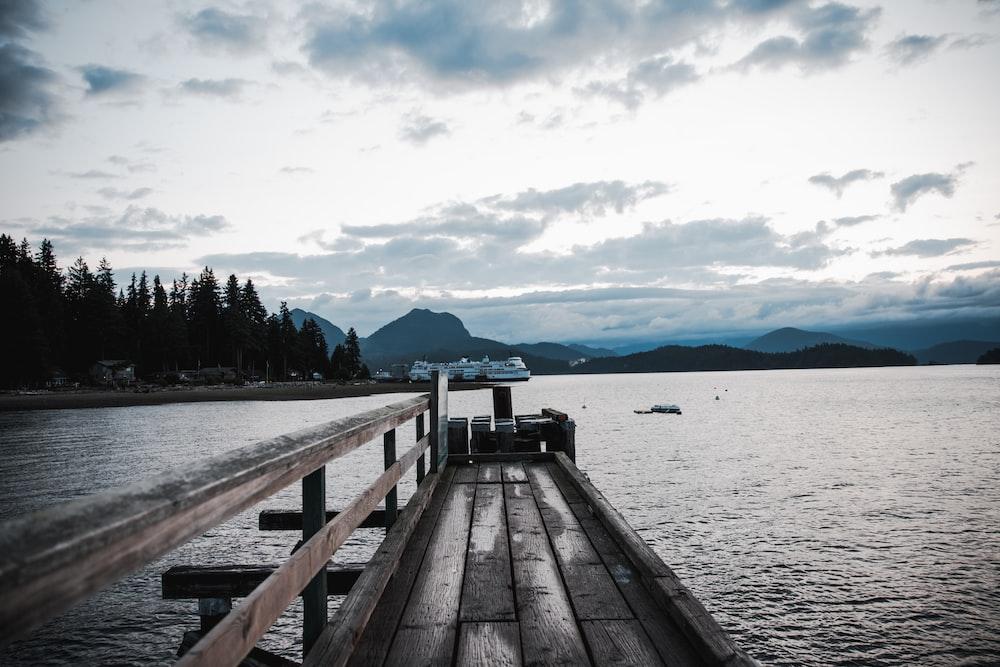 grey wooden dock during daytime