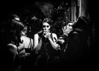 four women smoking together