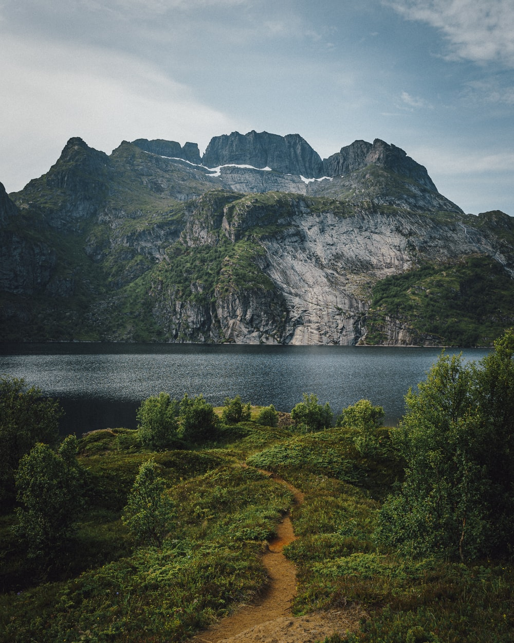 mountains near body of water