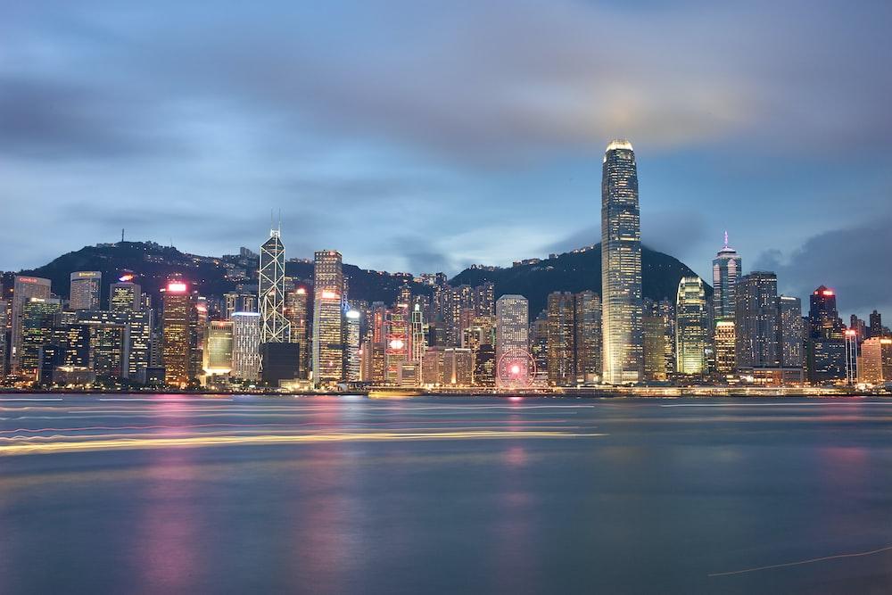 lighted city skyline across bay