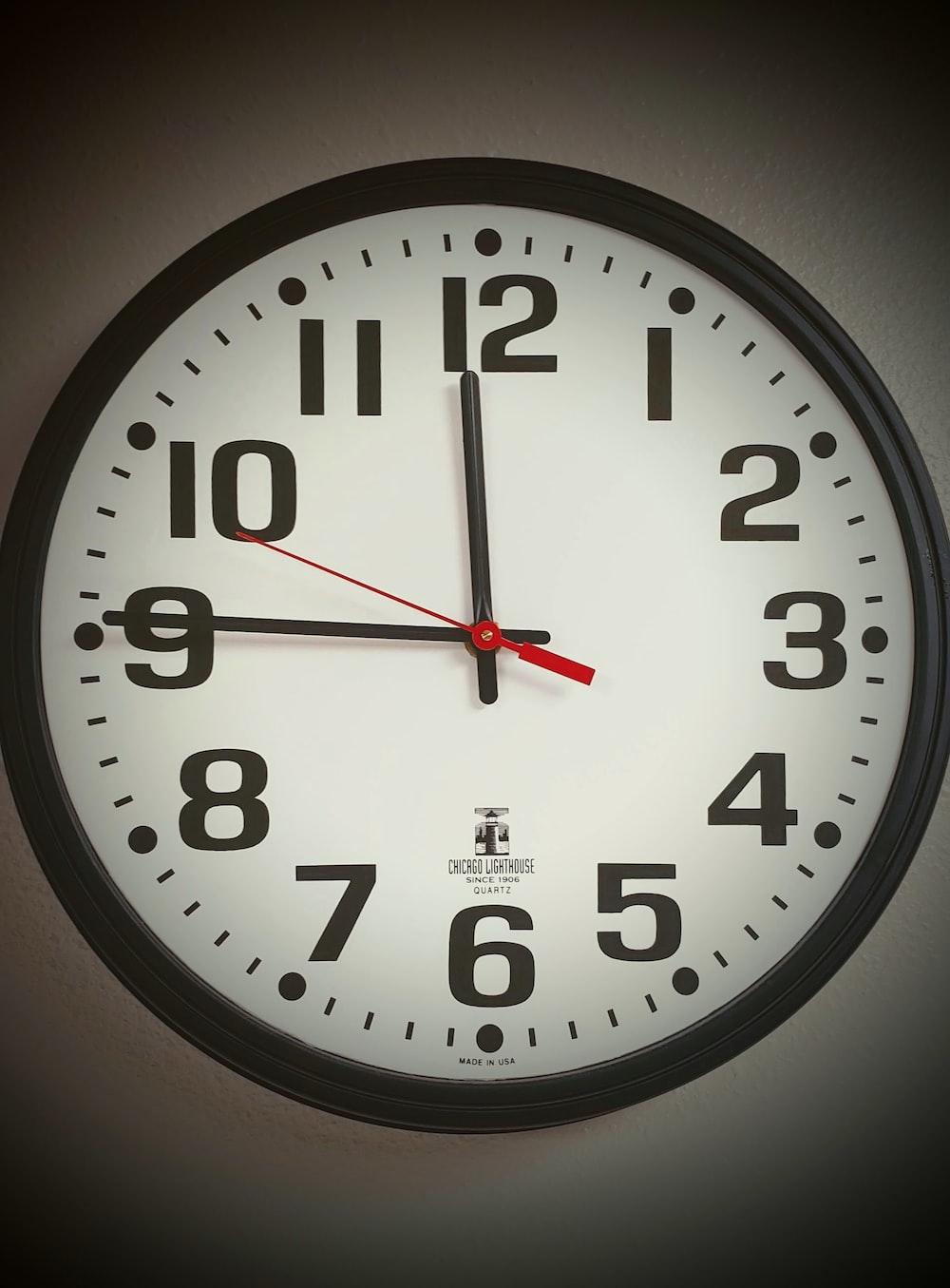 analog wall clock at 11:45