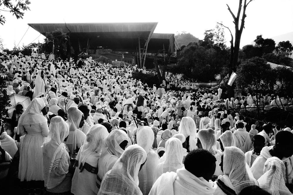 people in white clothes