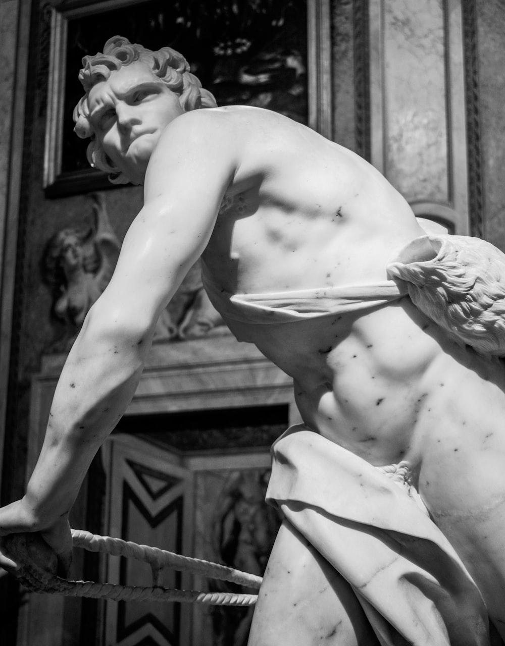 white concrete man statue close-up photography