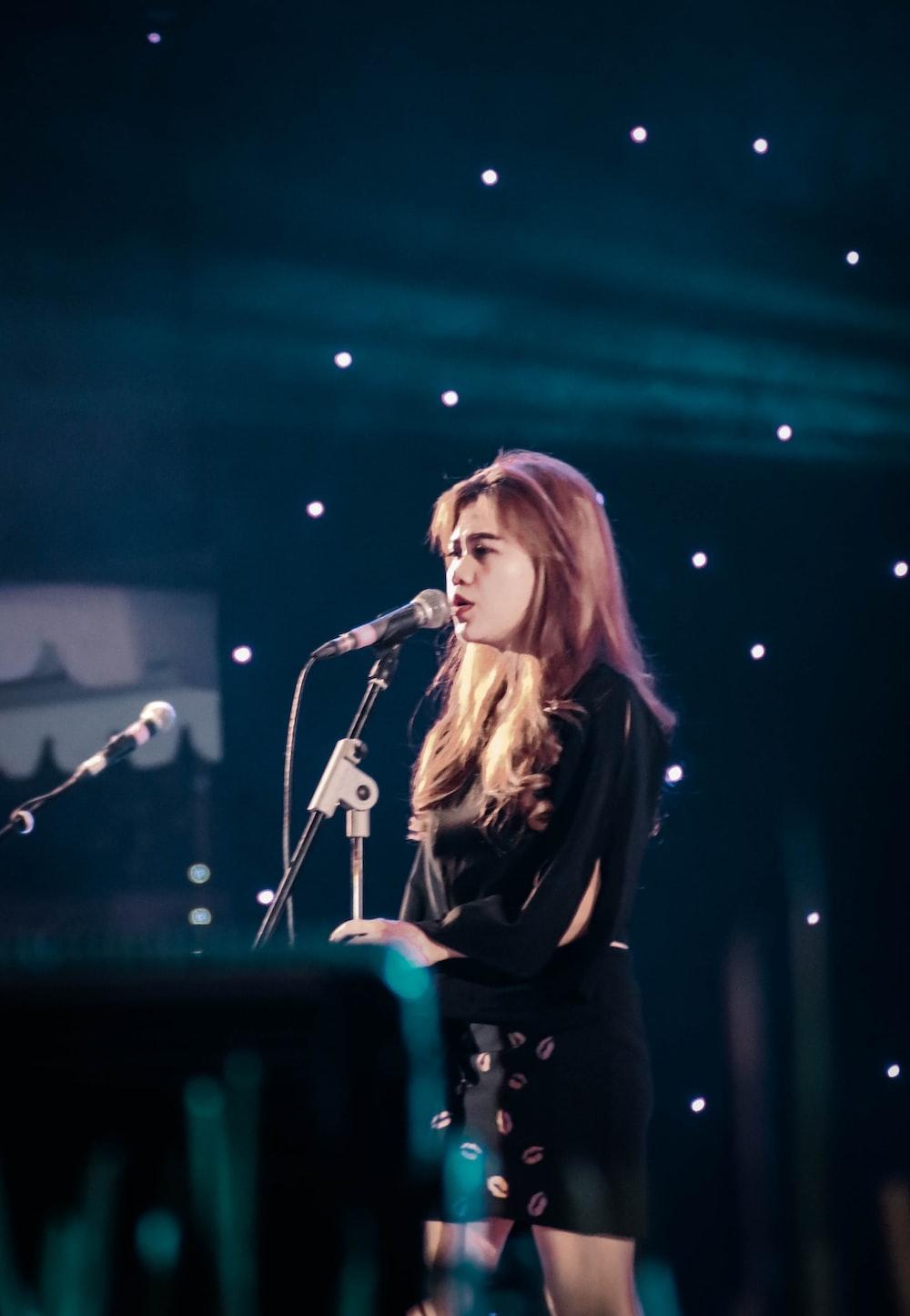 singing woman wearing black shirt
