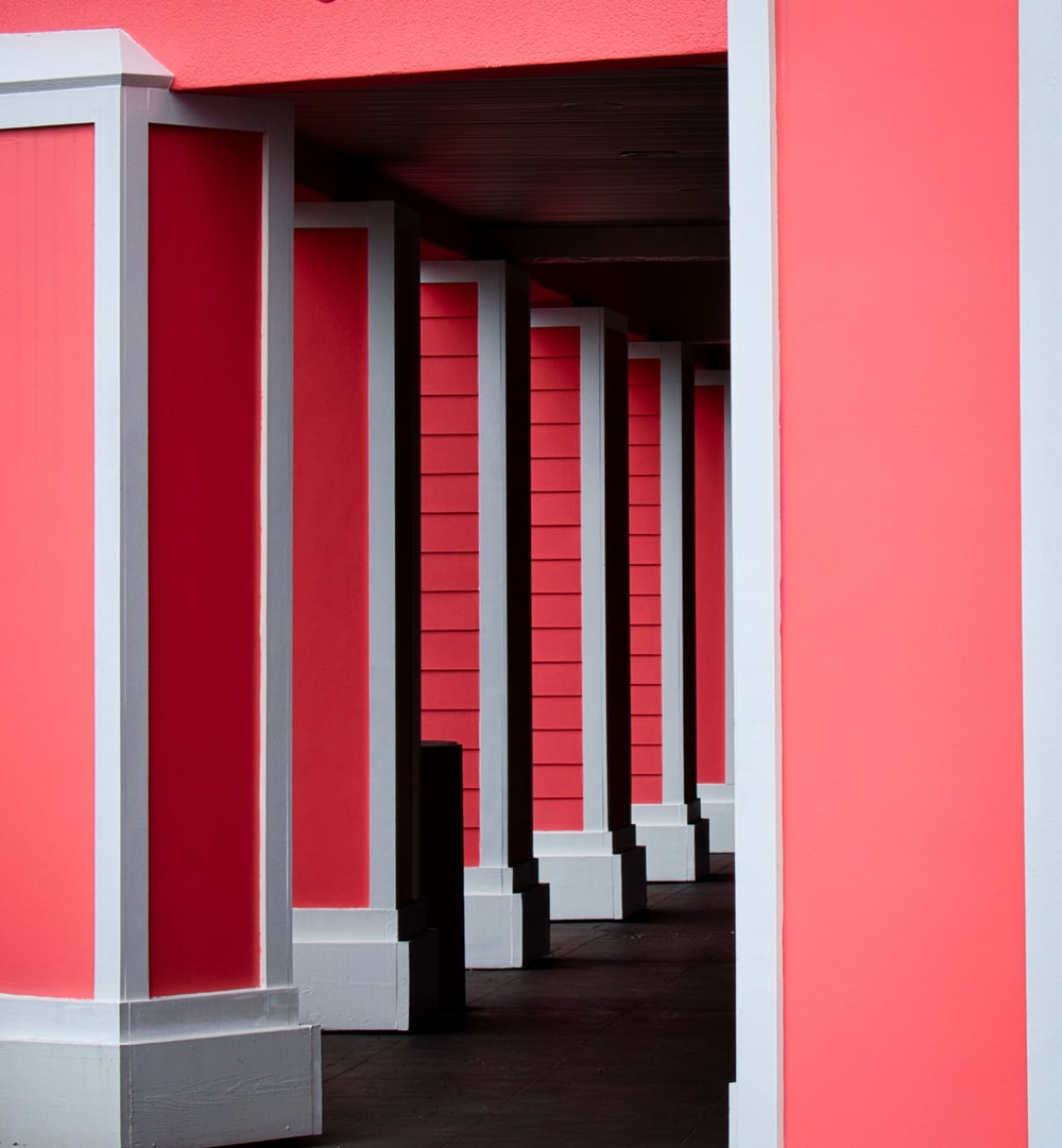 red and white concrete pillars