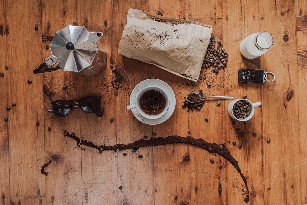 coffee beans beside teacup