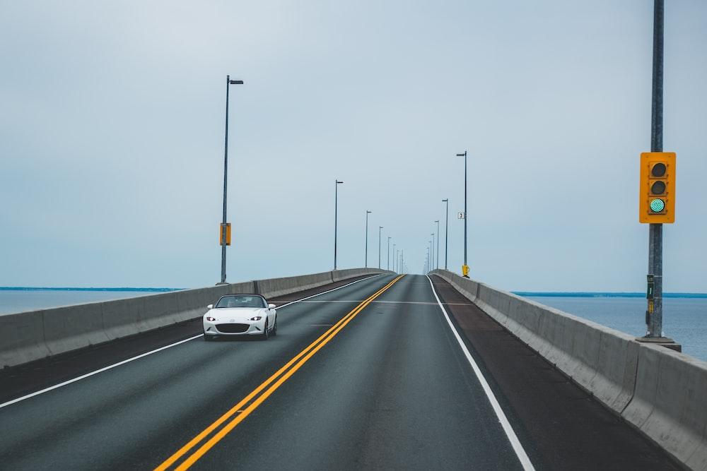 car on bridge road during day