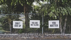 don't give up. You are not alone, you matter signage on metal fence