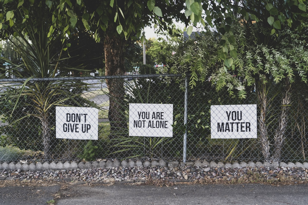 don't give up signs