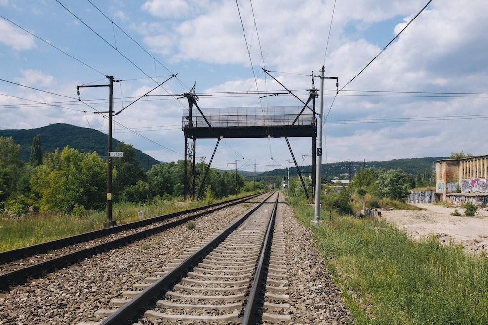 gray metal train railings