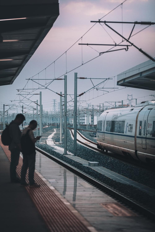 two men on a train platform