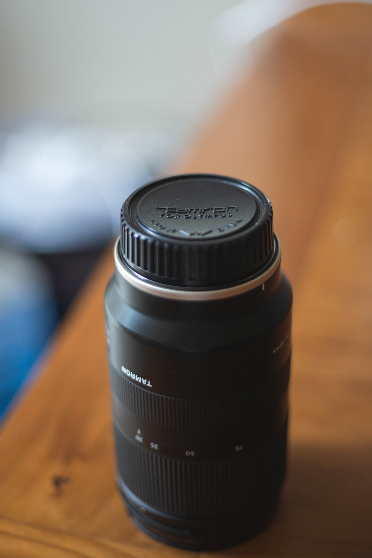 black camera lens on edge of table