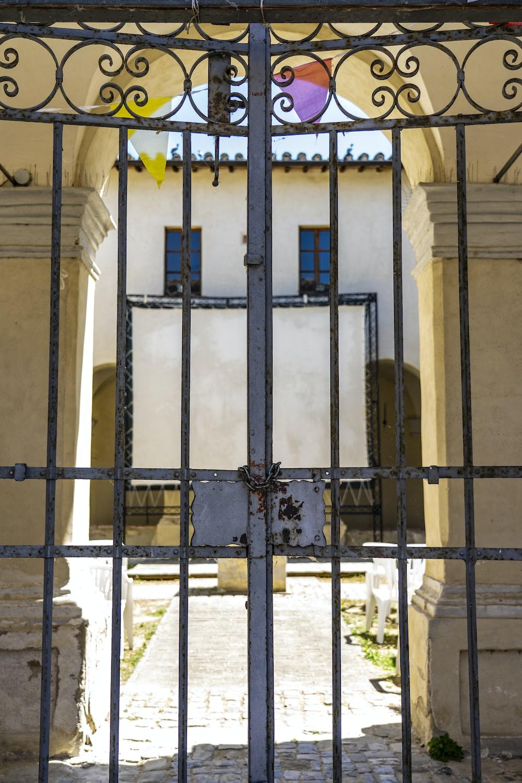 gray metal gate during daytime