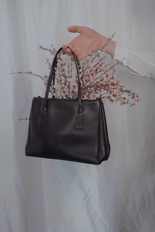 flowers in brown leather handbag