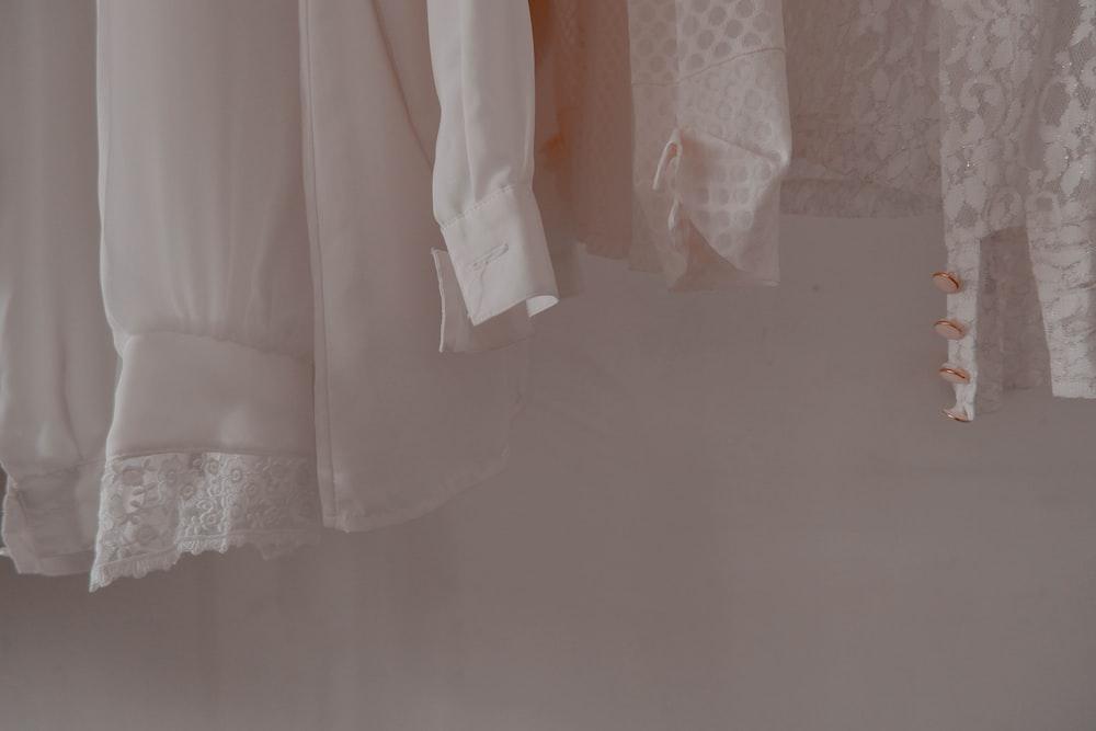 hanged white shirts