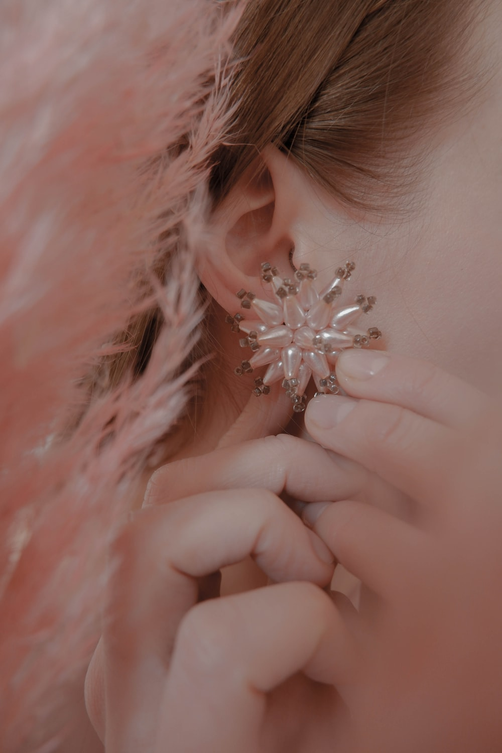 women's white earrings close-up photography