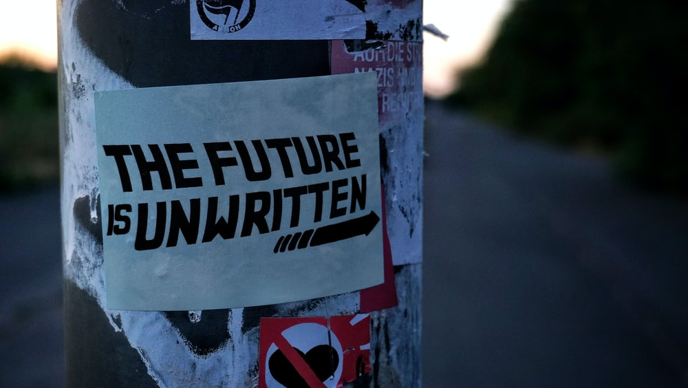 white and black the future is unwritten sticker close-up photography