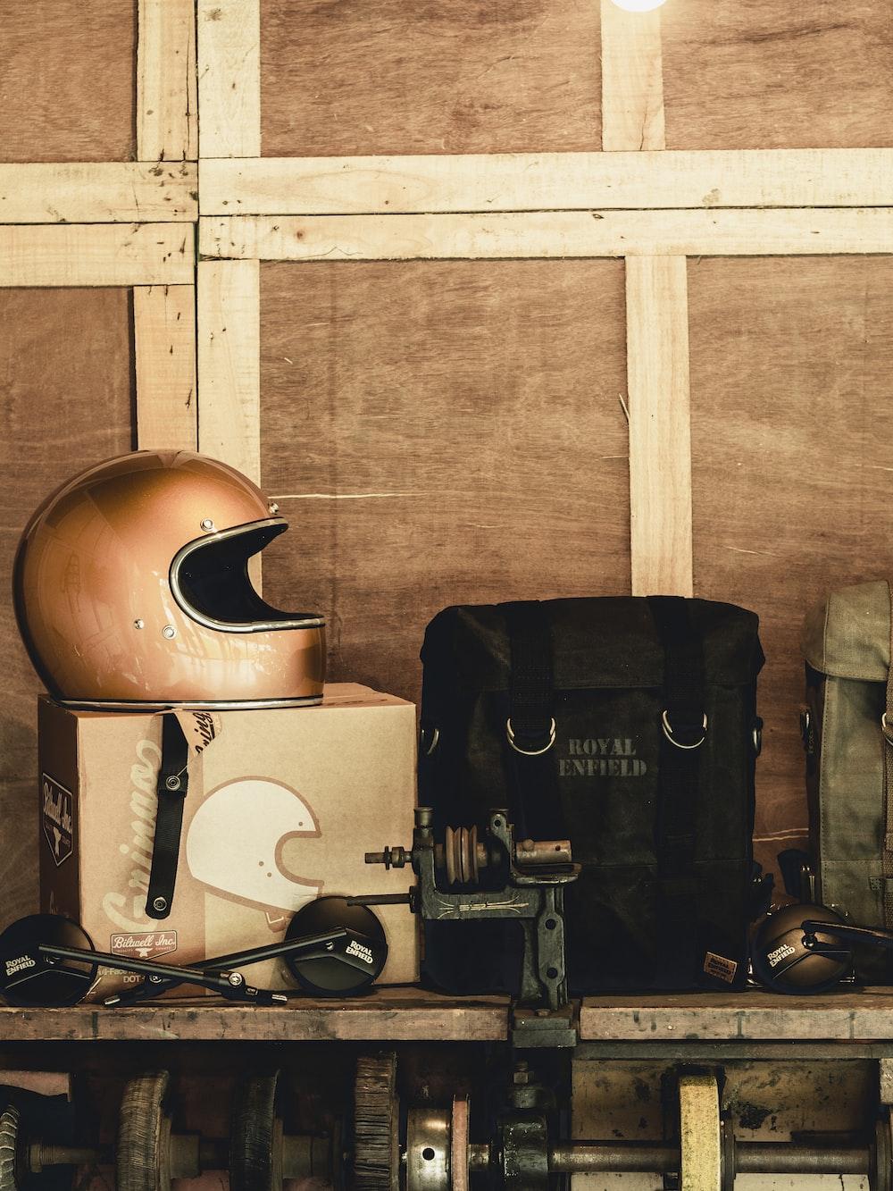 brown helmet on box