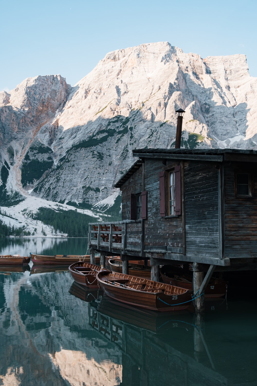 gray wooden house on a lake