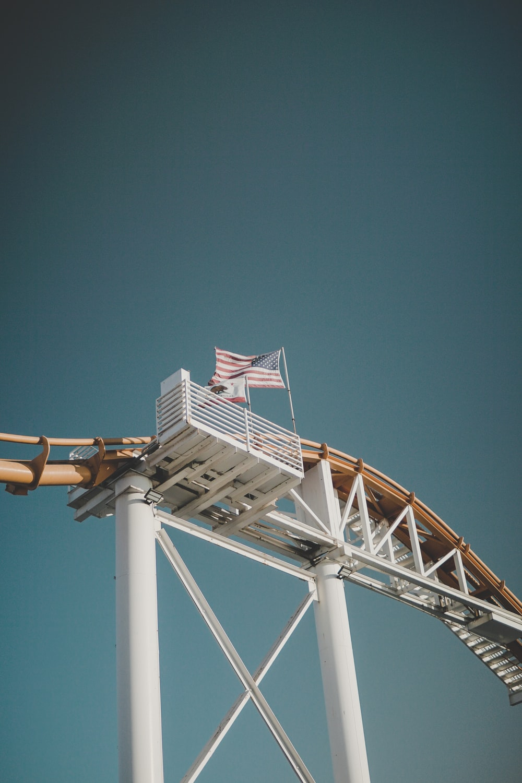 waving USA flag in roller coaster rail