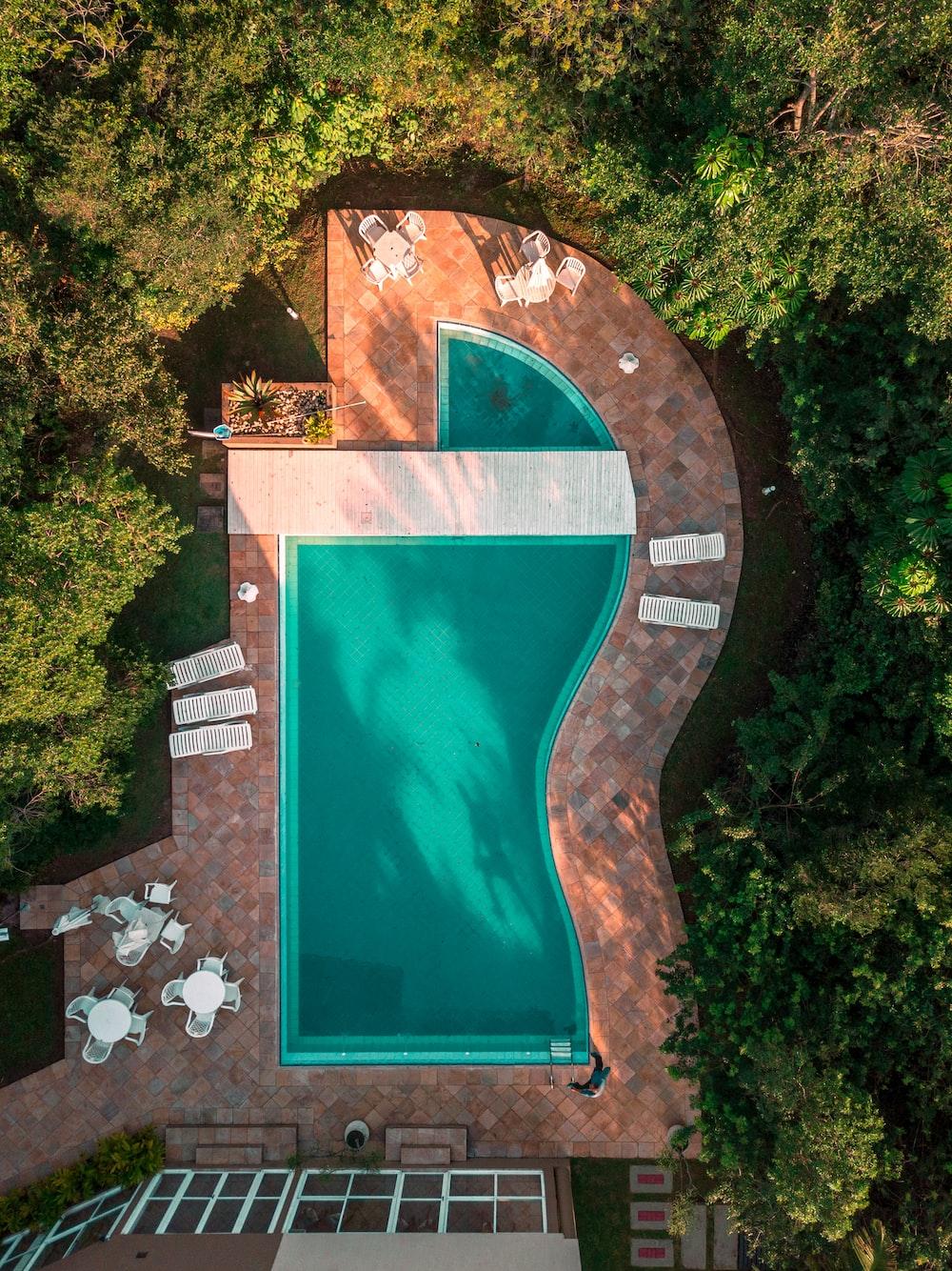 aerial photo of swimming pool between trees
