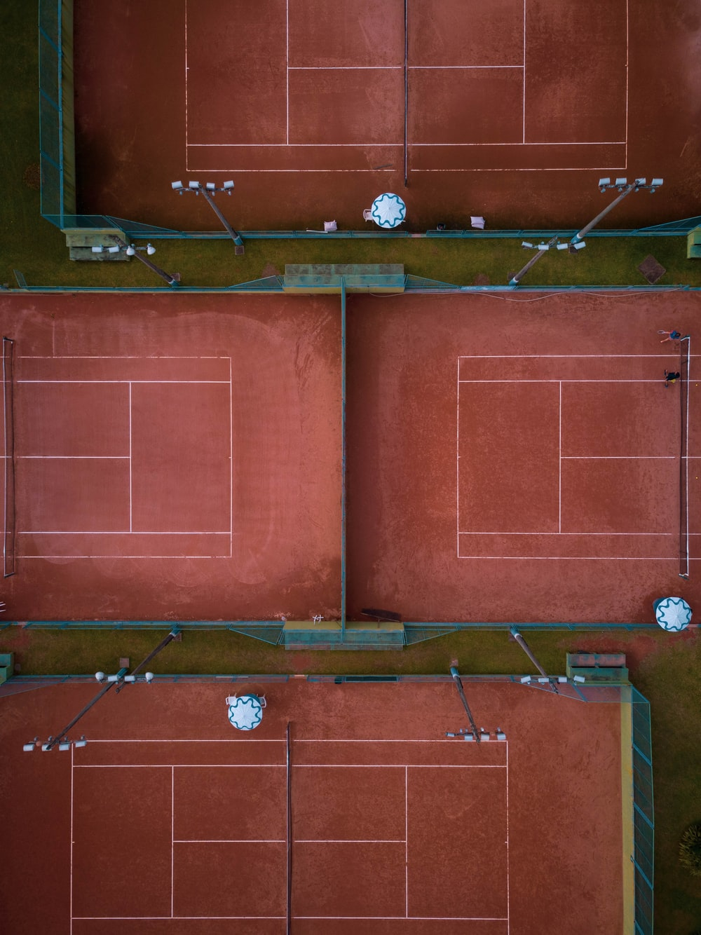 aerial view of four tennis courts