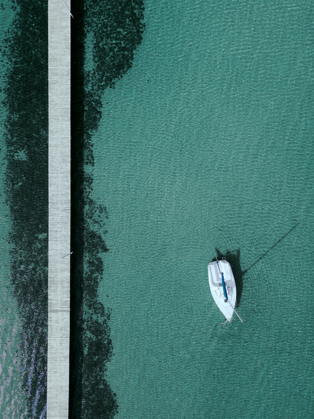 white boat in body of water during daytime
