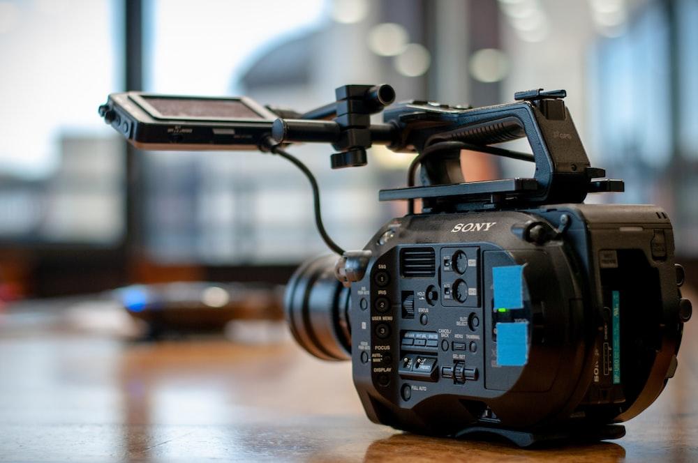 black video recorder on floor