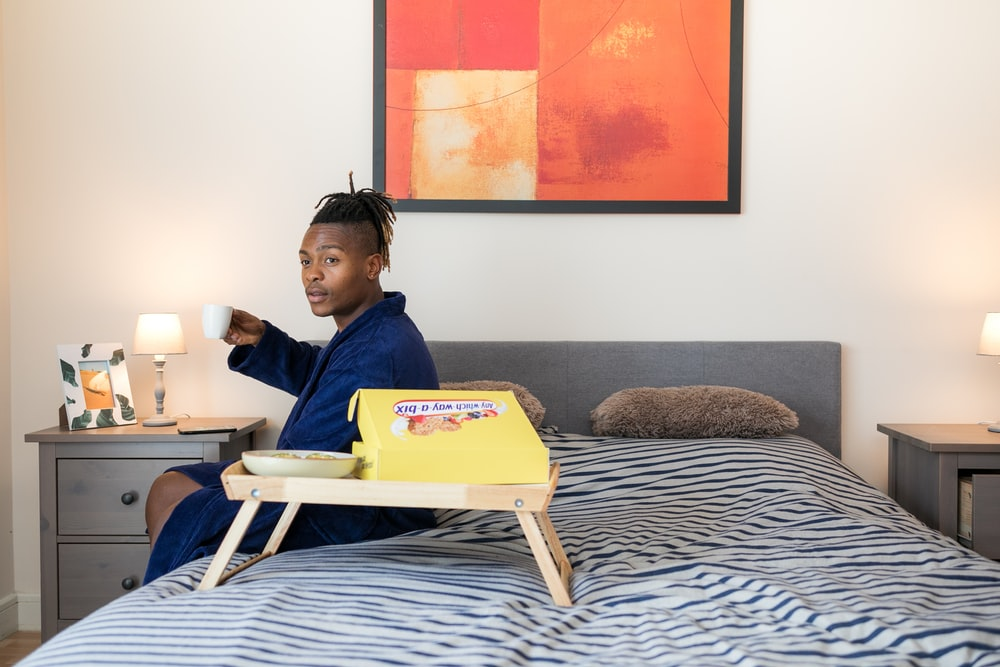 man sits on bed